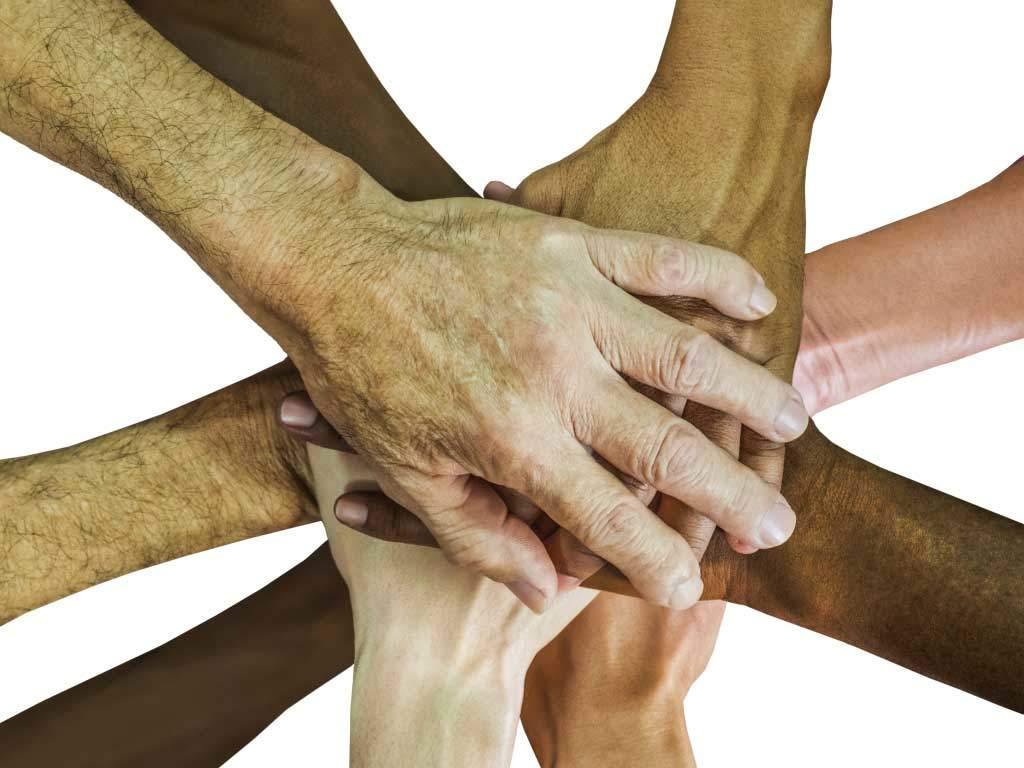 Teamworkbild- Haende zusammengehalten werden